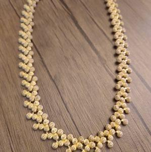 Elegant gold toned evening necklace